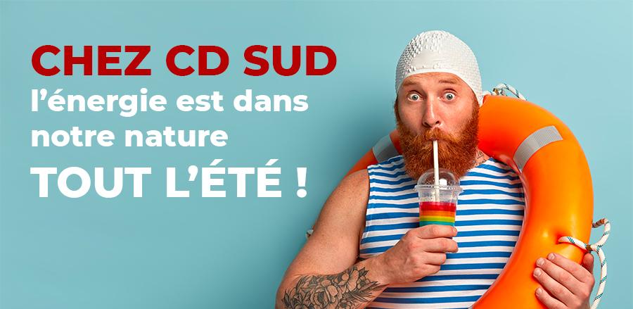 Chez cd sud l'energie est dans notre nature tout l'été. Homme  barbu en maillot buvant un jus de fruit avec une bouée autour du coup.