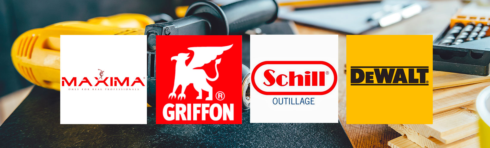 Outillage posé sur une table avec logo Maxima Griffon Schill Dewalt